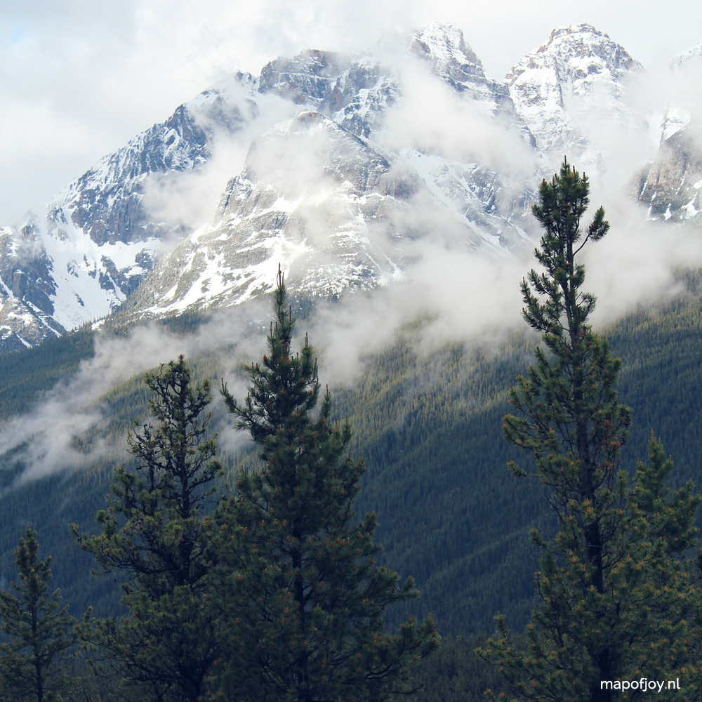 Rocky Mountains in the fog, Icefields Parkway, Alberta, Canada - Map of Joy