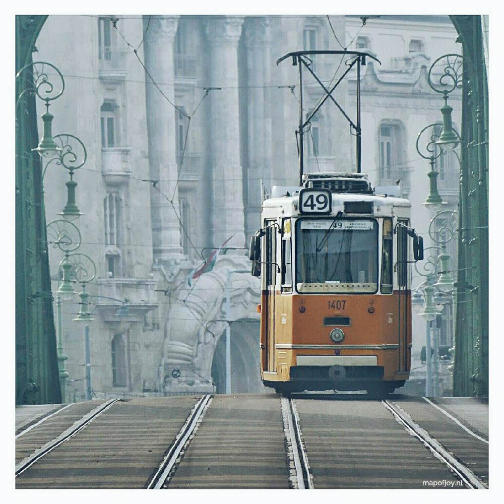 Old tram crossing bridge in Budapest - Map of Joy
